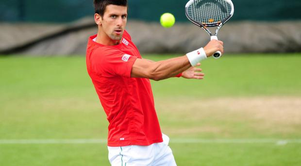 Serbia's Novak Djokovic on the practice courts during a practice day of the 2012 Wimbledon Championships at the All England Lawn Tennis Club, Wimbledon