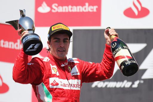 VALENCIA, SPAIN - JUNE 24: Fernando Alonso of Spain and Ferrari celebrates on the podium after winning the European Grand Prix at the Valencia Street Circuit on June 24, 2012 in Valencia, Spain. (Photo by Mark Thompson/Getty Images)