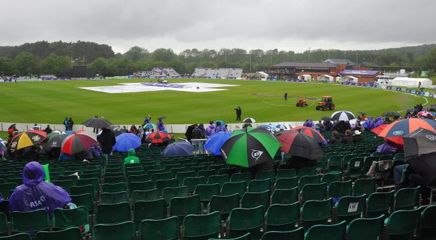 Spectators brave the elements at Stormont but it was to be a fruitless wait as they only got to see 10.4 overs