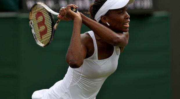 LONDON, ENGLAND - JUNE 25: Venus Williams of USA returns the ball during her womens singles first round match against Elena Vesnina of Russia on day one of the Wimbledon Lawn Tennis Championships at the All England Lawn Tennis and Croquet Club on June 25, 2012 in London, England. (Photo by Clive Rose/Getty Images)