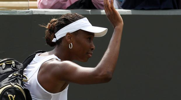 LONDON, ENGLAND - JUNE 25: Venus Williams of USA leaves the court dejected after her womens singles first round match against Elena Vesnina of Russia on day one of the Wimbledon Lawn Tennis Championships at the All England Lawn Tennis and Croquet Club on June 25, 2012 in London, England. (Photo by Clive Rose/Getty Images)
