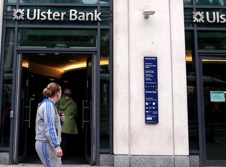 Customers at the Ulster Bank branch in Donegall Square East, Belfast. A computer glitch has meant that around 100,000 people in Northern Ireland have had trouble accessing the money in their accounts