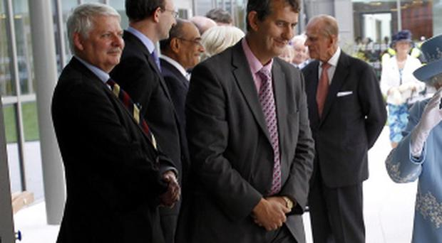 Queen Elizabeth II and the Duke of Edinburgh visit the South West Acute Hospital in Enniskillen, County Fermanagh, watched by Health Minister Edwin Poots, during a two-day visit to Northern Ireland as part of the 2012 Diamond Jubilee tour.
