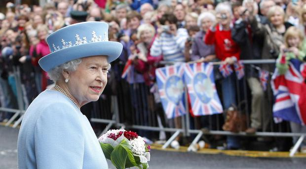 Queen Elizabeth II outside St. Macartin's Cathedral in Enniskillen, County Fermanagh, during a two-day visit to Northern Ireland as part of the 2012 Diamond Jubilee tour.