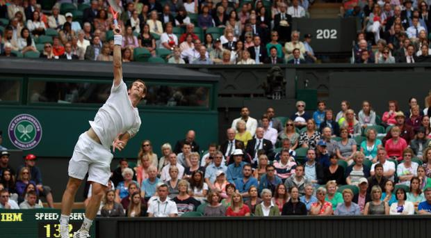 LONDON, ENGLAND - JUNE 26: Andy Murray of Great Britain serves during his Gentlemen's Singles first round match against Nikolay Davydenko of Russia on day two of the Wimbledon Lawn Tennis Championships at the All England Lawn Tennis and Croquet Club on June 26, 2012 in London, England. (Photo by Clive Brunskill/Getty Images)