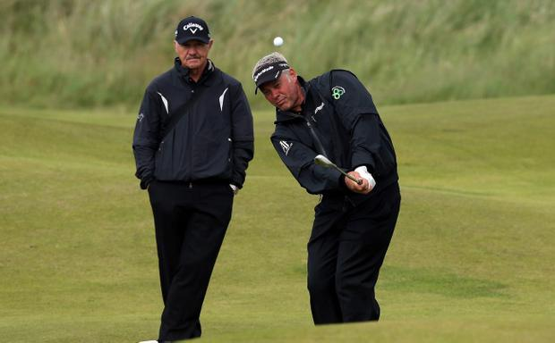 PORTRUSH, NORTHERN IRELAND - JUNE 26: Darren Clarke of Northern Ireland chipping under the watchful eye of coach Pete Cowen of England during practice for the 2012 Irish Open held on the Dunluce Links at Royal Portrush Golf Club on June 26, 2012 in Portrush, Northern Ireland. (Photo by David Cannon/Getty Images)