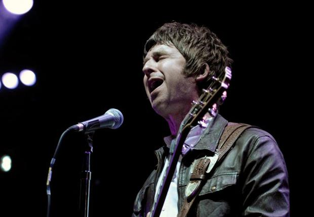 Noel Gallagher of the British band Oasis performs during their concert at Staples Center in Los Angeles, Thursday, Dec. 4, 2008. (AP Photo/Chris Pizzello)