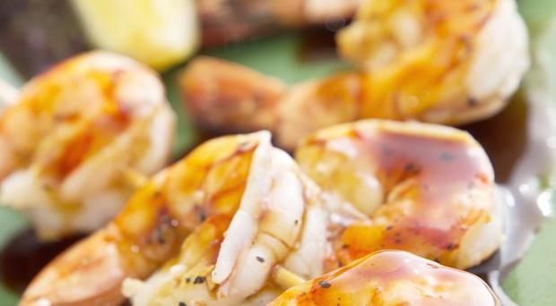 Whole grilled tiger prawns with a green chilli,honey & lime dressing