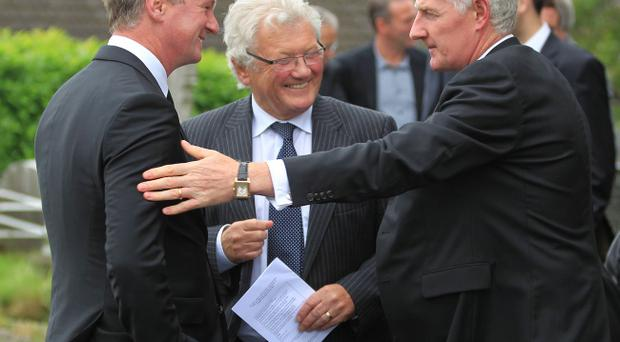 Northern Ireland manager Michael O'Neill, football commentator Jackie Fullerton and former Northern Ireland manager Nigel Worthington attend the funeral of Alan McDonald