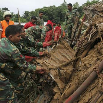 Rescuers search for survivors and bodies following landslides on the outskirts of Chittagong, Bangladesh (AP)