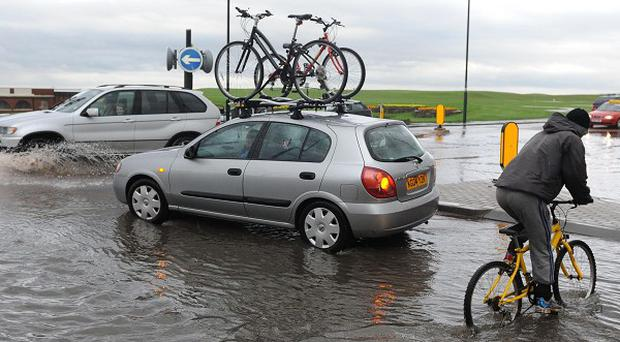 Flooding in Whitley Bay, North Tyneside, as heavy rain and thunderstorms battered parts of central and northern England