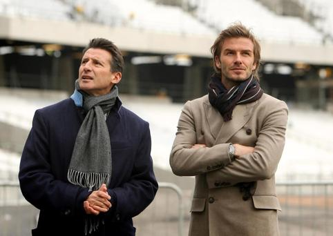 David Beckham (right) and Chair of the London 2012 Organising Committee Lord Coe, during a visit to the Olympic Stadium in 2010