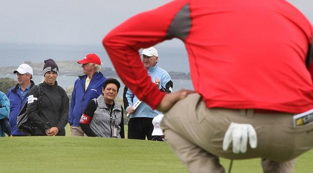 Rory McIlroy lines up a putt at the Irish Open