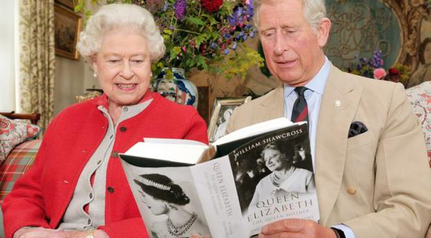 Prince Charles st reads Queen Elizabeth The Queen Mother, The Official Biography'in a living room at Birkhall the Scottish home of the Prince and Duchess of Cornwall (Photo by John Stillwell-WPA Pool/Getty Images)
