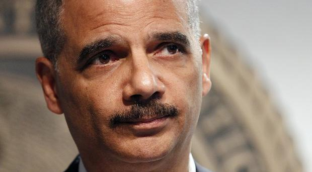 Attorney General Eric Holder has been held in criminal contempt of Congress by the US House of Representatives (AP)