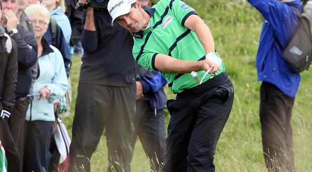 Ireland's Padraig Harrington plays a shot out of the rough during day two of the Irish Open at Royal Portrush