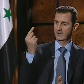 Activists say shelling by president Bashar Assad's forces has killed at least 43 people, mostly civilians (AP/IRIB TV)
