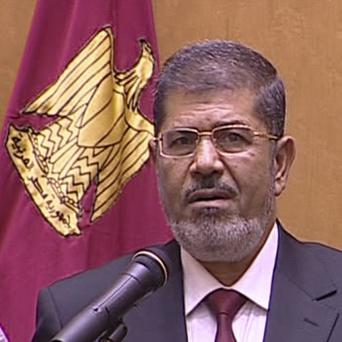 Egyptian President Mohammed Morsi is sworn in at the Supreme Consitutional Court in Cairo (AP)