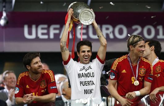 Spain's Cesc Fabregas holds the trophy at the end of the the Euro 2012 soccer championship final between Spain and Italy in Kiev