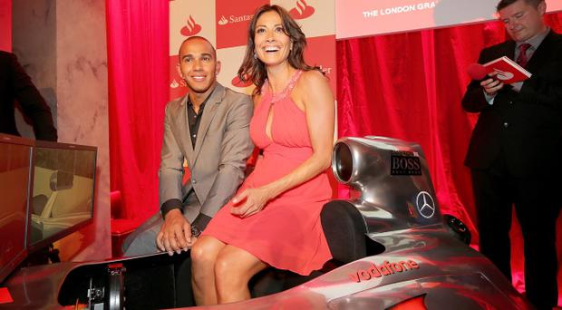 LONDON, ENGLAND - JUNE 28: (L to R) F1 driver Lewis Hamilton, TV presenter Melanie Sykes and Sky Sports F1 HD Commentator David Croft attend the launch of the London Grand Prix by Santander at the Royal Automobile Club on June 28, 2012 in London, England. (Photo by Mark Thompson/Getty Images)