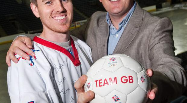 Team GB Olympic Ice Hockey player and Belfast Giant Stephen Murphy joins Harry Harpur from The Loop training consultancy to celebrate The Loop's recent team building activity with Team GB