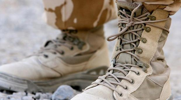 Three foreign troops have been killed by a man wearing an Afghan police uniform