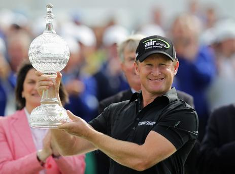 PORTRUSH, NORTHERN IRELAND - JULY 01: Jamie Donaldson of Wales celebrates with the trophy after winning the 2012 Irish Open held on the Dunluce Links at Royal Portrush Golf Club on July 1, 2012 in Portrush, Northern Ireland. (Photo by Dean Mouhtaropoulos/Getty Images)