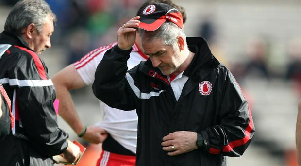 Tyrone manager Mickey Harte dejectedly walks off after his side's defeat