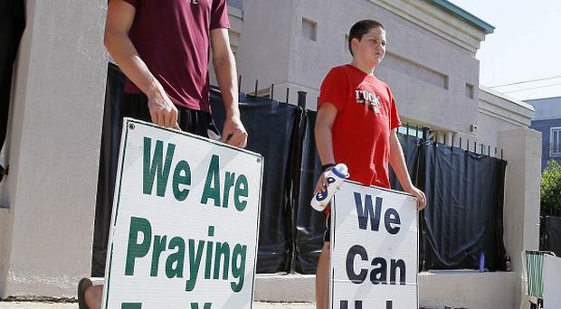 Anti-abortion advocates stand outside Mississippi's only abortion clinic (AP)
