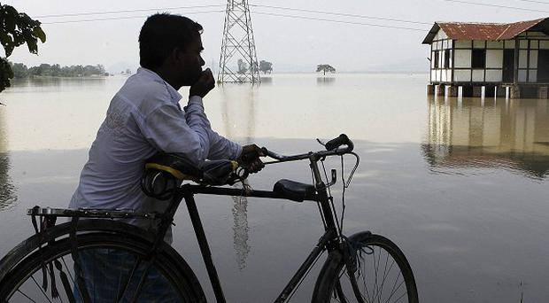 Floods have forced two million people to flee their homes in the Indian state of Assam (AP)