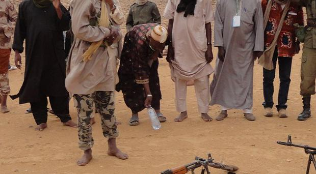 Islamist rebels from the Ansar Dine faction prepare to pray in the desert just outside Gao, Mali (AP)