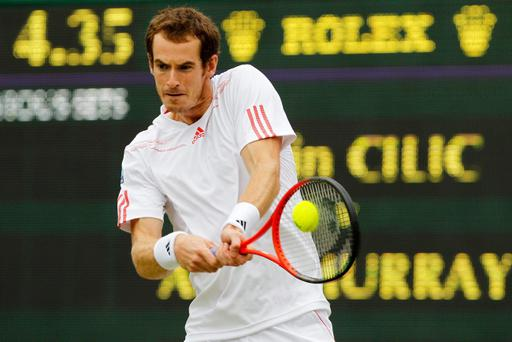 LONDON, ENGLAND - JULY 02: Andy Murray of Great Britain returns the ball during his Gentlemen's Singles fourth round match against Marin Cilic of Croatia on day seven of the Wimbledon Lawn Tennis Championships at the All England Lawn Tennis and Croquet Club on July 2, 2012 in London, England. (Photo by Paul Gilham/Getty Images)