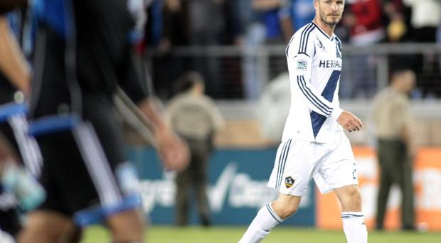 LA Galaxy's David Beckham walks off the field after his team lost to the San Jose Earthquakes 4-3 in a MLS soccer match in Stanford, California on Saturday, June 30, 2012. Beckham missed out on a place in Great Britain's Olympic football squad but could be named on manager Stuart Pearce's standby list (AP Photo/Mathew Sumner)