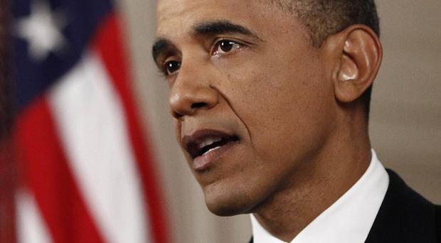 President Barack Obama has a small lead in the race to be re-elected, polls show (AP)