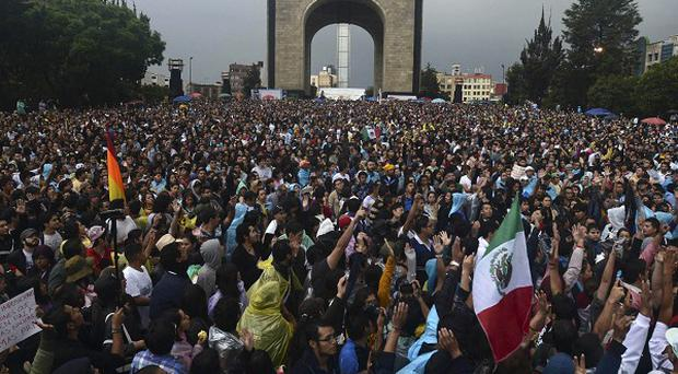 People gather at the Monument of the Revolution in Mexico City amid controversy over the presidential vote (AP)