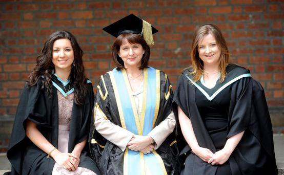 Cousins Lisa Messina (left) and Maeve Johnston (right) celebrate their graduation at Queens University along with Queens Pro-Chancellor Rotha Johnston (centre), who is Maeves mother and Lisas aunt.