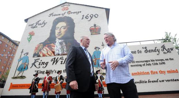 Loyalist Jackie McDonald (left) and artist Ross Wilson at the launch of a new mural in Sandy Row that has replaced a notorious depiction of a UFF gunman