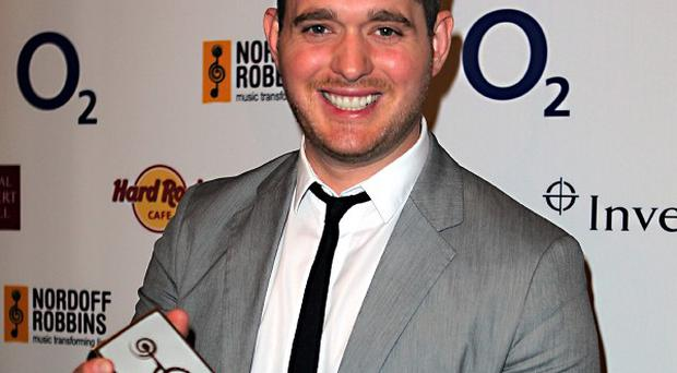 Michael Buble loves listening to music at home