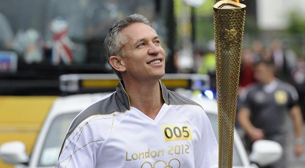Gary Lineker carries the Olympic Flame through Leicester