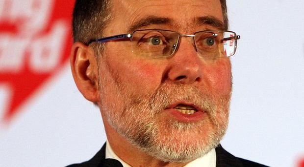 Nelson McCausland has accused Housing Executive contractors of poor workmanship and overcharging