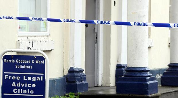 Police tape off the scene at Morris, Goddard and Ward solicitors in St John's Street, Devizes