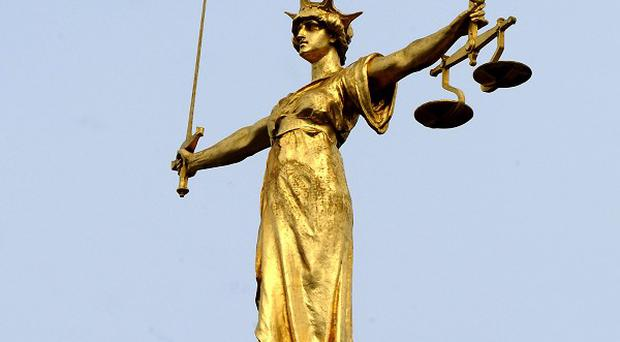 A man is due in court after a solicitor was shot at an office in Devizes