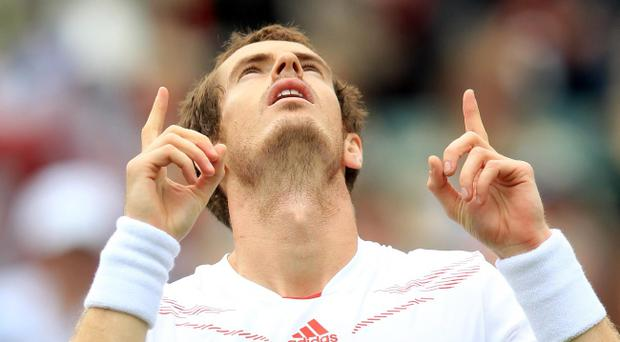 Great Britain's Andy Murray celebrates defeating Croatia's Marin Cilic during day eight of the 2012 Wimbledon Championships at the All England Lawn Tennis Club, Wimbledon
