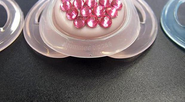 One of several 'bling' dummies studded with small imitation gems seized by trading standards officers as they could cause choking
