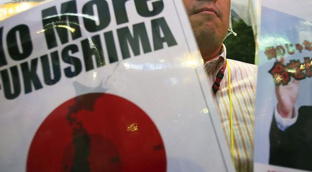 A protester during a rally against the restart of Ohi nuclear power plant, in Tokyo (AP)