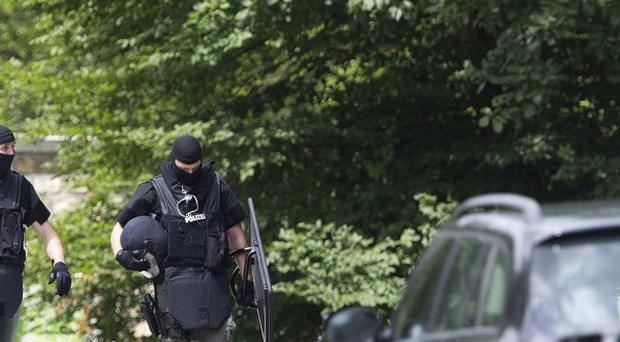 Police outside the German apartment block when a gunman killed four people arriving to evict him (AP)