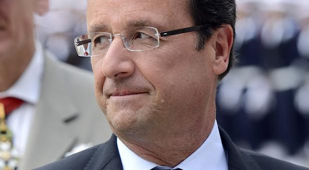 French President Francois Hollande is said to want to hike taxes on holiday homes (AP)