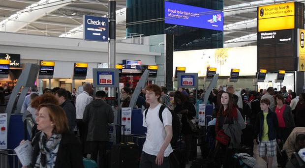 Twelve airlines have agreed to change their practice of springing last-minute fees on debit card payments