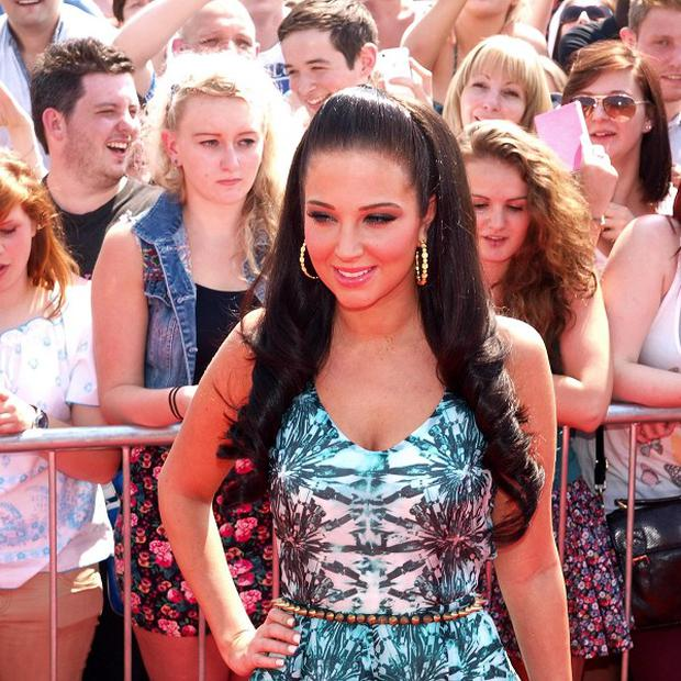 Tulisa Contostavlos denied making a gang sign while filming her latest video