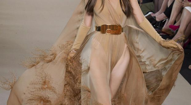 A model wears a creation by French designer Stephane Rolland as part of his presentation for Women's Fall Winter 2013 haute couture fashion collection, in Paris, France, Tuesday, July 3, 2012.